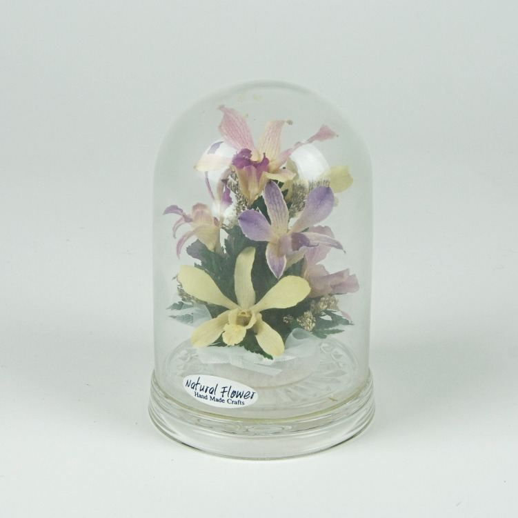 Plastic flowers bell jar ornament