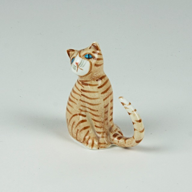Curly tail ceramic cat ornament
