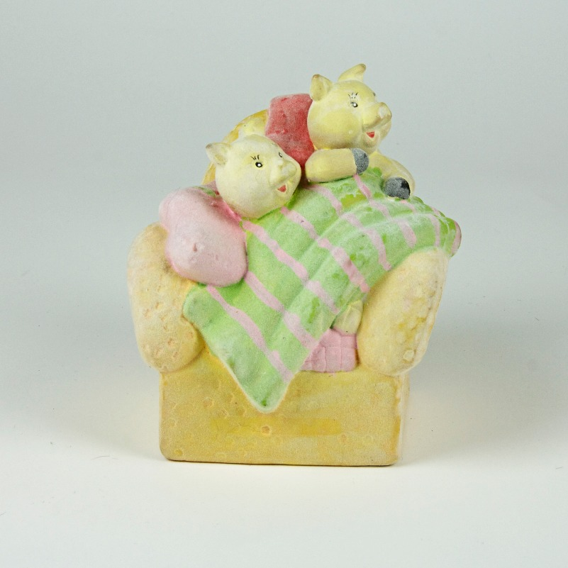 Flocked pigs on a sofa money bank