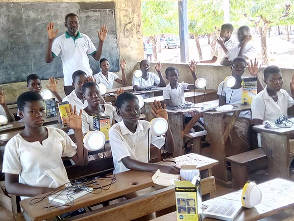 Solar lamps donated to a school. Lamps in class. kids in Kpele, a village in Togo