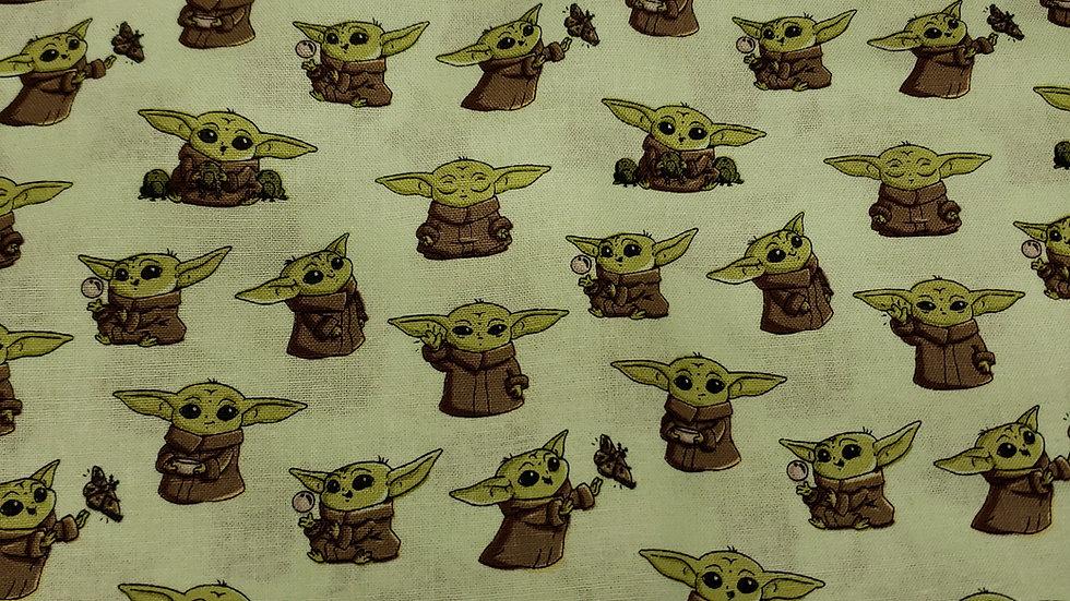 "Baby Yoda ""Grogu"" in green"