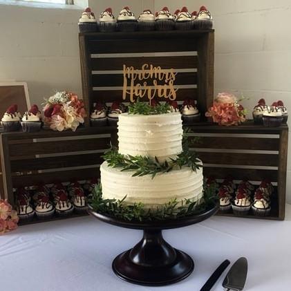Elegant white cake with greenery.
