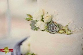 Beautiful roses and Succulents surrounded by delicate piping work.