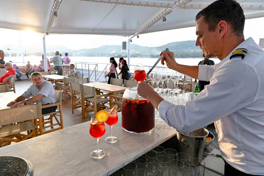 Purser Udo Serving Sunset Drinks.jpg