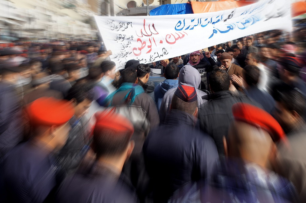 """Arab Spring - after Friday prayers in Amman"" by CharlesFred is licensed under CC BY-NC-SA 2.0"