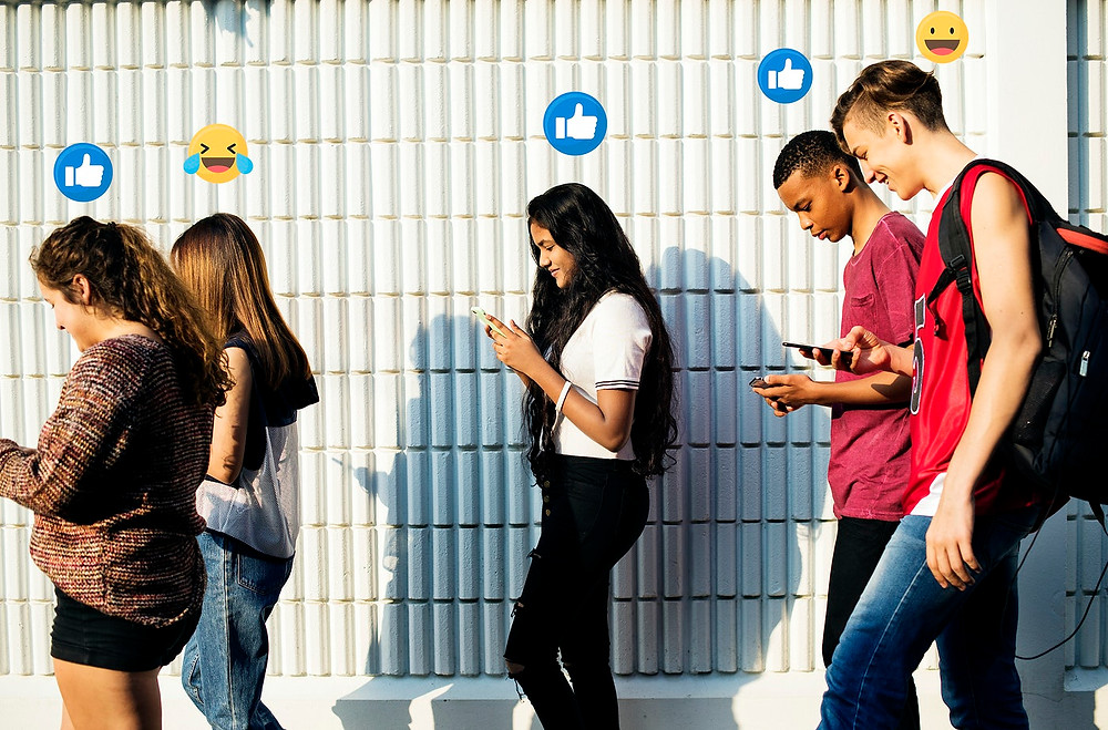 youngsters communicating with brands on social media Rawpixel