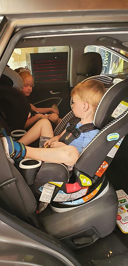 Multiple kids in car seats.