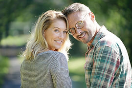 Portrait of mature couple enjoying sunny