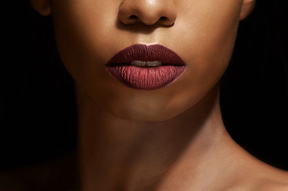 Close up of a female face with burgundy lipstick