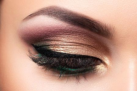 Close up of beautiful woman eye with multicolored smokey eyes makeup. Modern fashion make