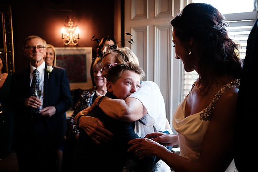 A young boy overcome by emotion at his mums weddings