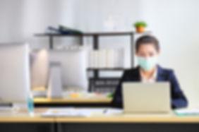 Female employee wearing medical facial m