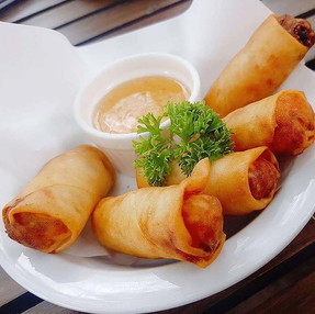 SPRING ROLLS SERVED WITH SWEET CHILI SAUCE