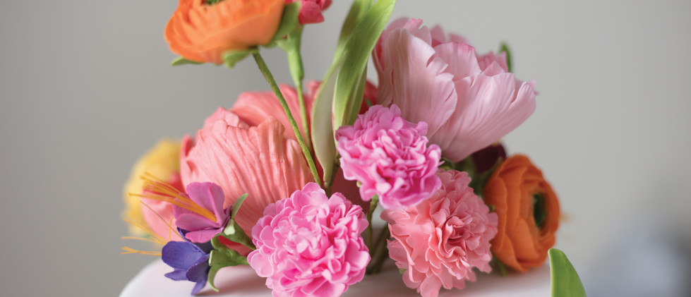 Festive Ranunculus and Carnations