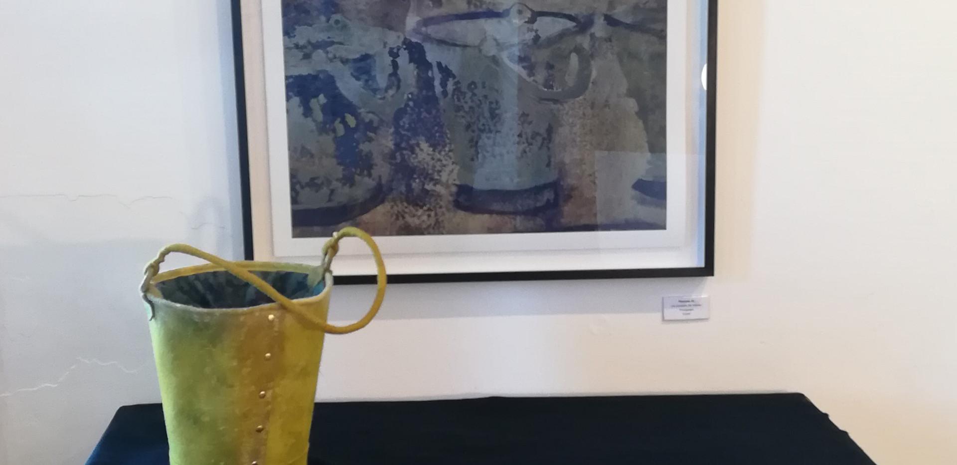 """""""Die Obsessie, 17 Emmers"""", monoprint by Theresa Jo. R4500 """"Die Obsessie, die emmer"""" photograph by Theresa Jo. R3500 Camoflage felt bucket by Ronel Jordaan. R850"""