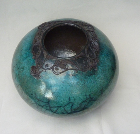 Wire work by Lesley - Ann Hoets. Raku fired earthenware