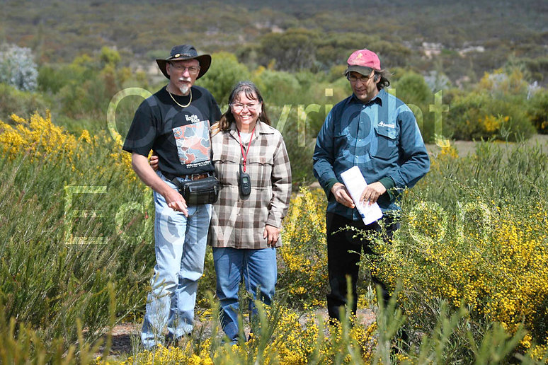 Eddy and Donna Wajon standign in revegetation at at GondwanaLink property Chingarrup Sanctuary with Greening Australia's Barry Heydenrych