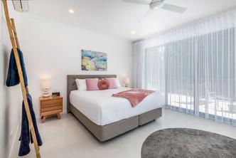 Soft fresh furnishings for the master bedroom.