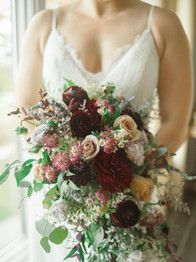 Bride holding bouquet - Laura Gares Photography