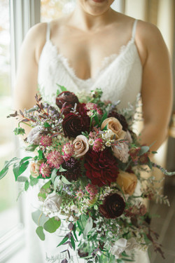 A close-up image of the bride holding her bouquet.