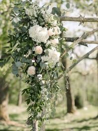 Wedding Ceremony Arbor with flowers - Historic Stonebrook Farm - Between Pines Photography