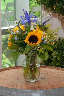 A close-up image of a sunflower arrangement as a reception table centerpiece.