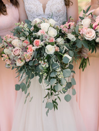 Close up of bride and bridesmaids holding bouquets - Historic Stonebrook Farm - Between Pines Photography