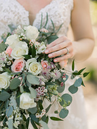Bride holding bouquet - Historic Stonebrook Farm - Between Pines Photography
