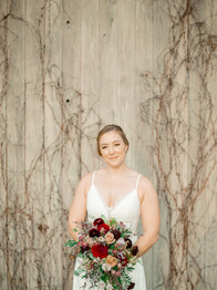 Bride with bouquet - Laura Gares Photography