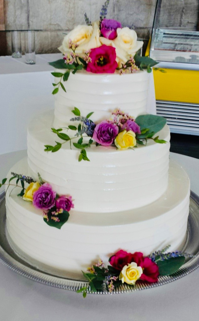 Asymmetrical tiered flowers with floral cake topper