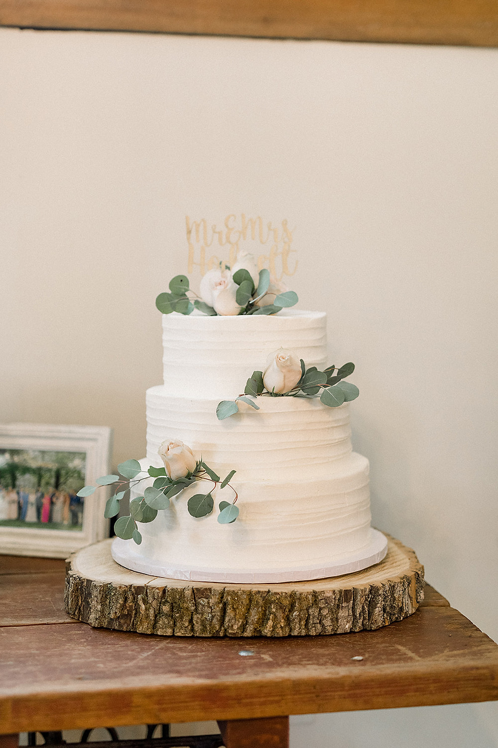 Simple rose and greens on 3-tier cake. Photo by Between Pines.
