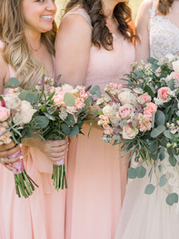 Bride and bridesmaids holding bouquets - Historic Stonebrook Farm - Between Pines Photography
