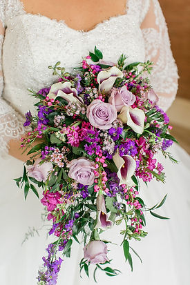 Spring wedding bouquet with lavender and soft pink flowers