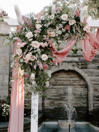 Wedding ceremony arbor with flowers - Bluestone Country Club - Jieru Photography