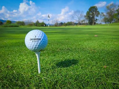 Golf-ball-on-tee.jpeg