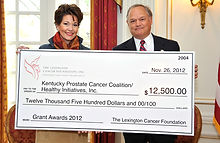 Heather French Henry & Steve Henry accept a grant from the Lexington Cancer Coalition.