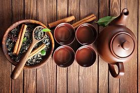 Green tea with ceramic utensils on woode