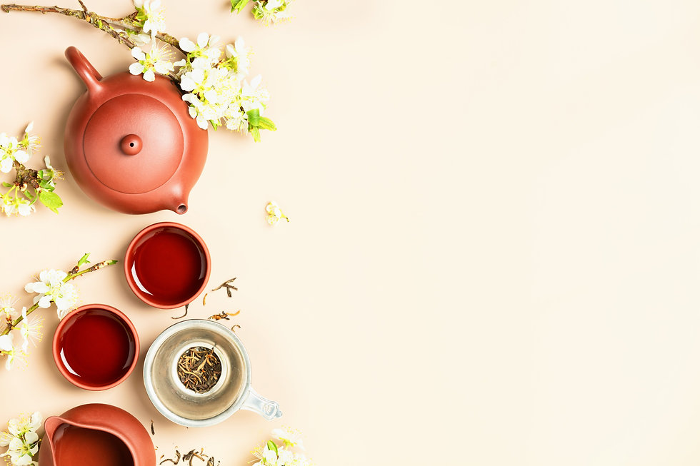 Asian Tea set on stone slate board, ceramic teapot, cups, dried tea and spring branches, t