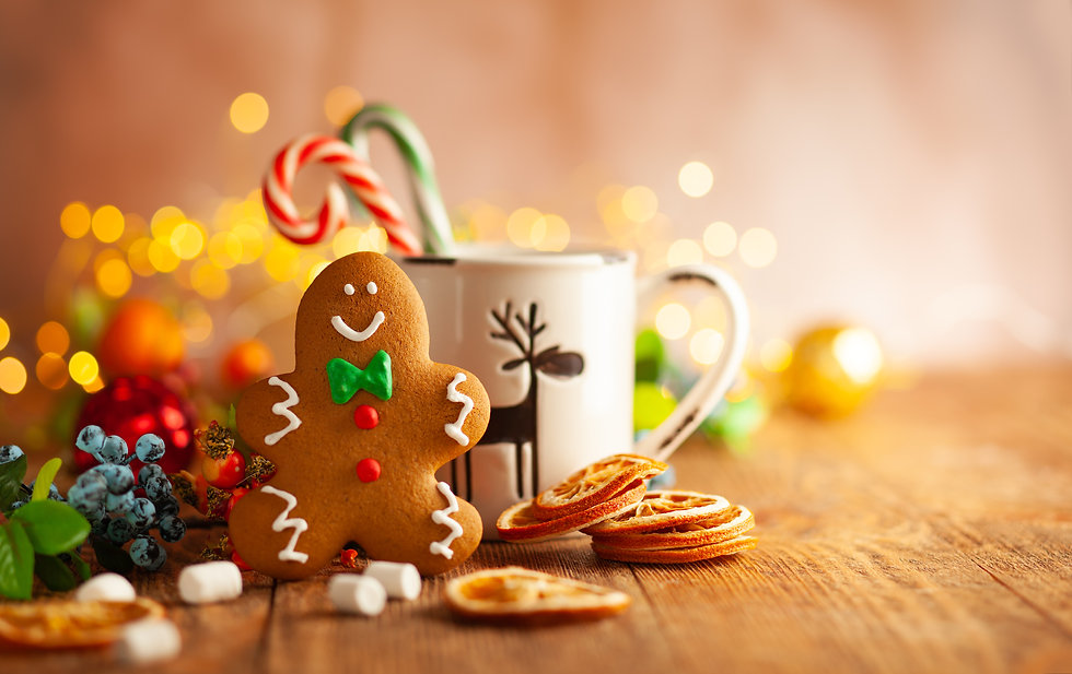 Christmas gingerbread cookies with Christmas decorations on wooden background. Traditional