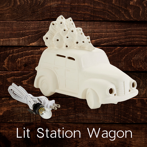 LIT STATION WAGON WITH TREE