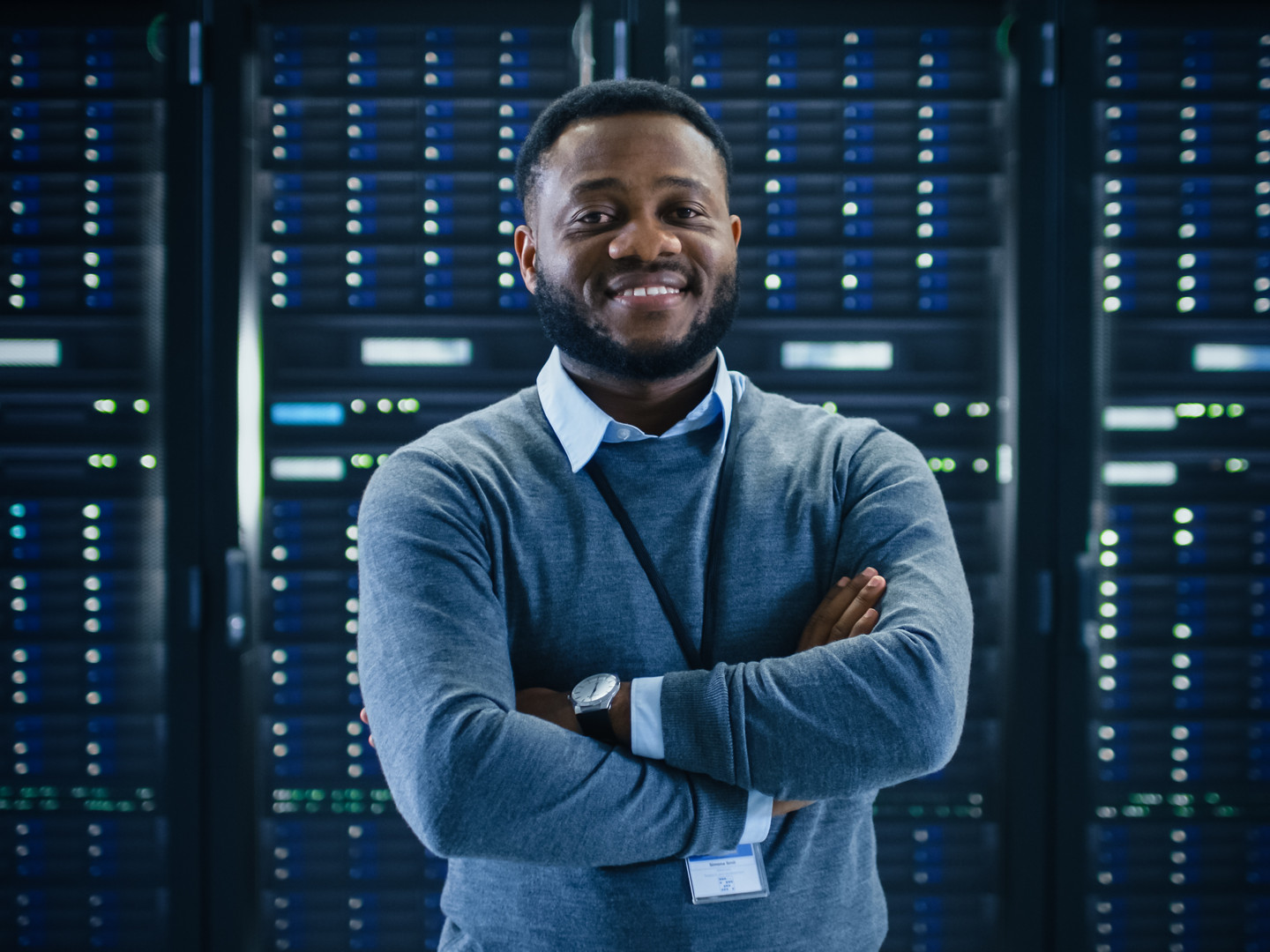 Bearded Black IT Engineer Standing and P