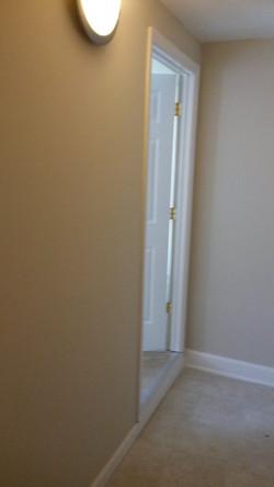 Bedroom to Bathroom hallway and bathroom entry door_edited.jpg