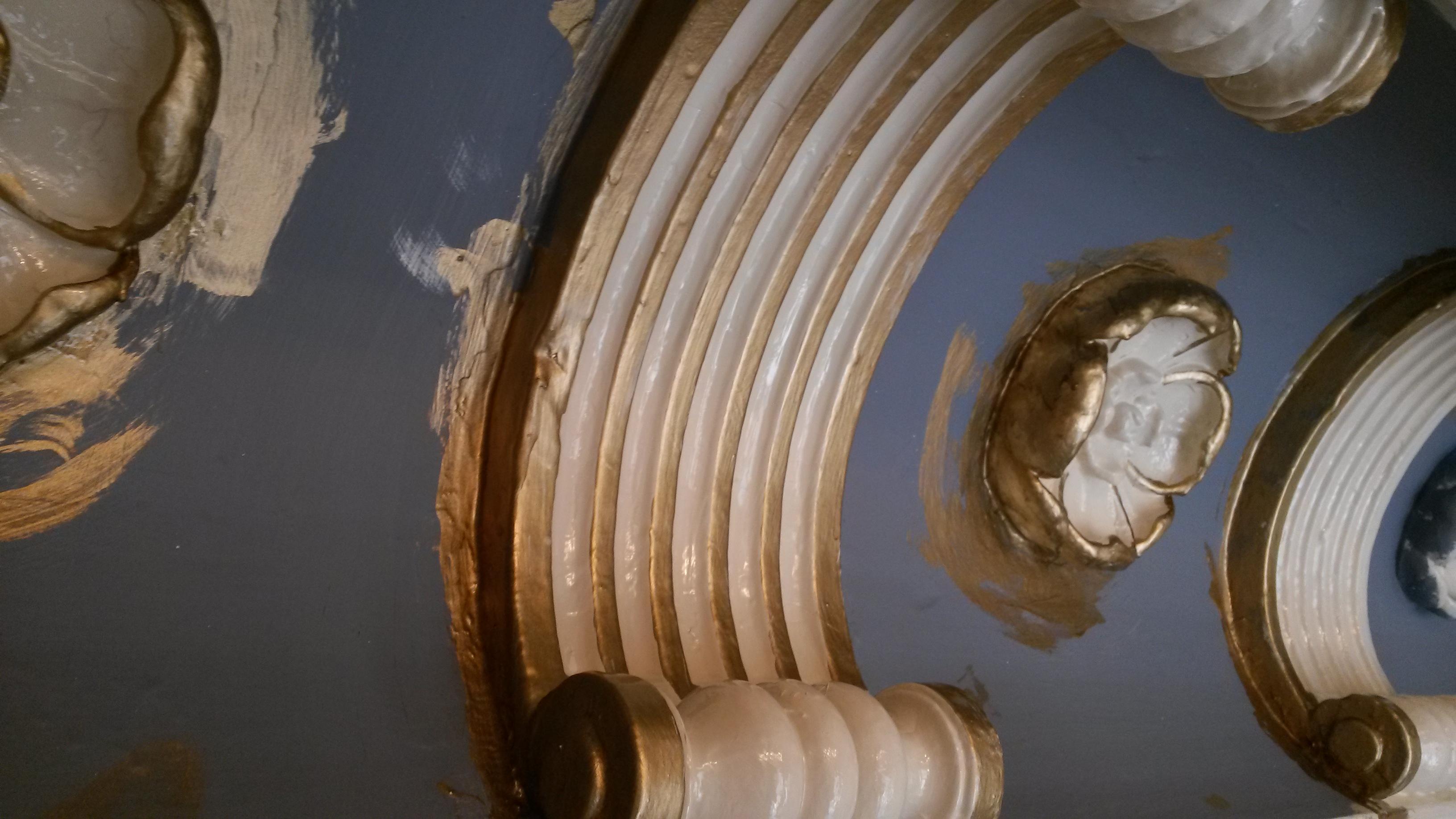 Historical plaster gold leaf restoration.jpg