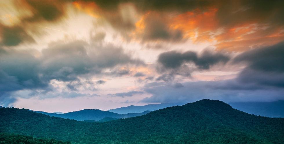 Grey sky over mountains