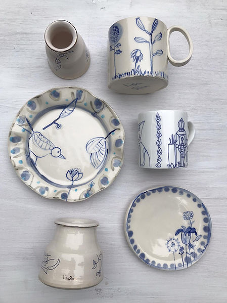 collection of handmade blue and white ceramic plate, mug, medicine jar. Painted with traditional cobalt blue oxide.