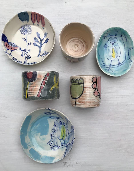 collection of handmade illustrated ceramic dish, plant pots and plates. hand painted with birds and flowers