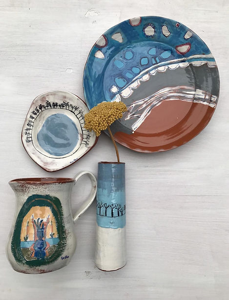 Collection of handmade illustrated ceramic plate, dish, jug and vase. Terracotta and hand painted. Inspired by the Northern Women's Art Collective. Theme of travel. Souks and brilliant blues. Featuring Enki God of Creativity and Life