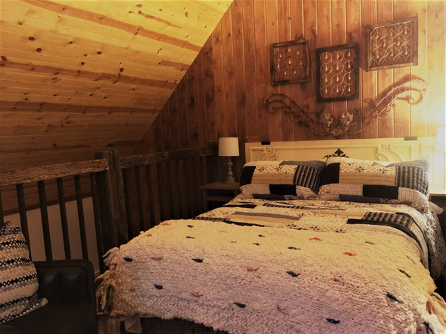 Highnote bed with railing in bedroom loft