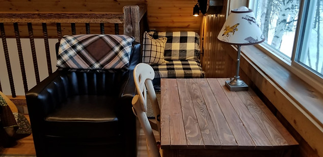 Each cabin has a desk with a view and cozy chair in the bedroom loft