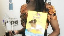 """""""I'm A Big Sister Now"""" Wins Ben Franklin Award"""